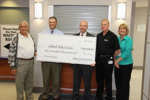 LCCF's Armand Peterson, vice president and Kyle Marcolla, board member, with Hedrick Medical Cetner's Matt Wenzel, CEO; Bob Moore, manger of Radiology; and Lisa Hecker, director of HR