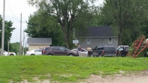 Members of the Carroll Co. Sheriff's office and the Missouri State Highway Patrol discuss strategy during a standoff in Tina, Mo. June 16th, 2015.