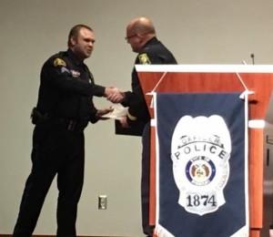 Sgt. Bosch accepting award.
