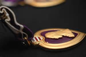 Missouri measure to end fees for Purple Heart license plates