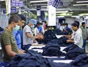 Employees work inside a garment factory of Orient Craft Ltd. at Gurgaon