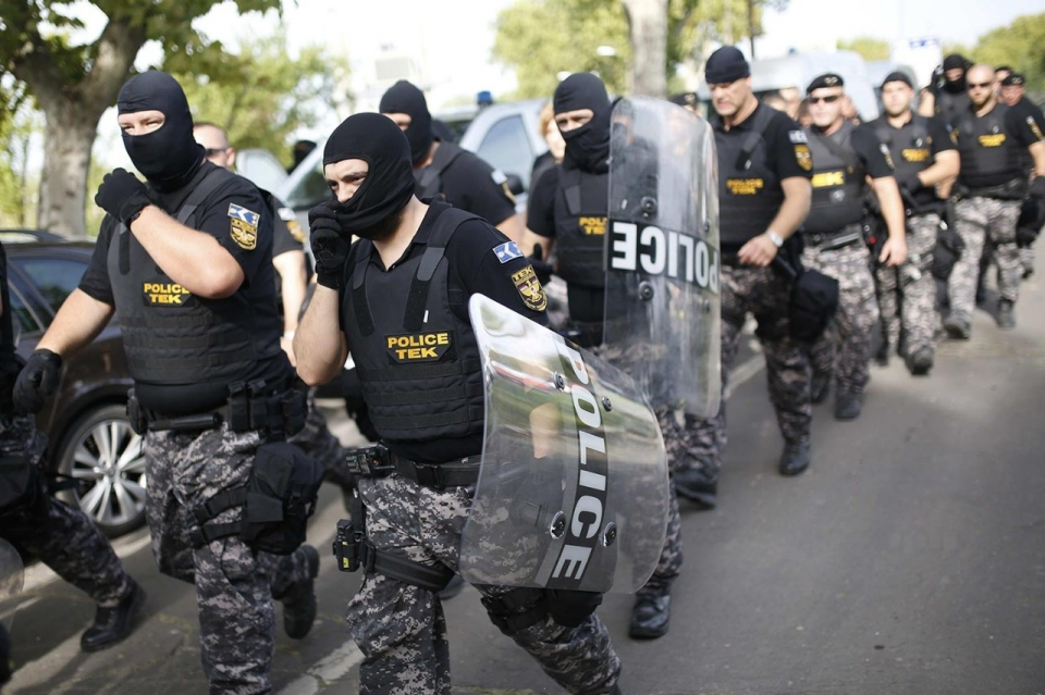 Riot police use tear gas, water cannons at border with Serbia