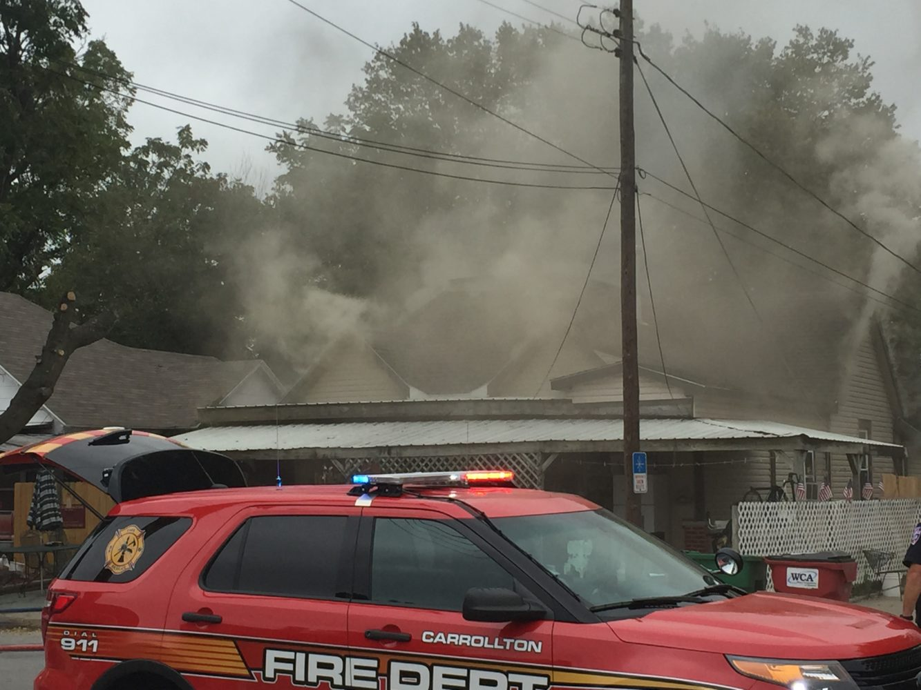 Officials fight flames in Carrollton home