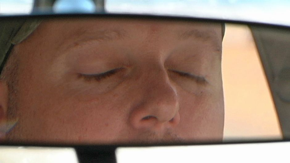 Drowsy driver hospitalized after off-road excursion