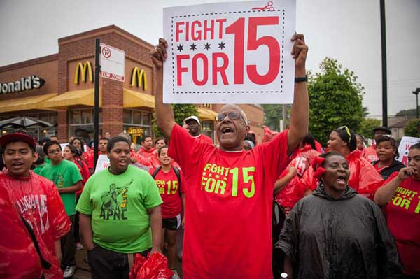 Low wage workers rally for higher compensations