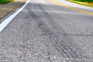 skid-marks-along-country-road-19075493