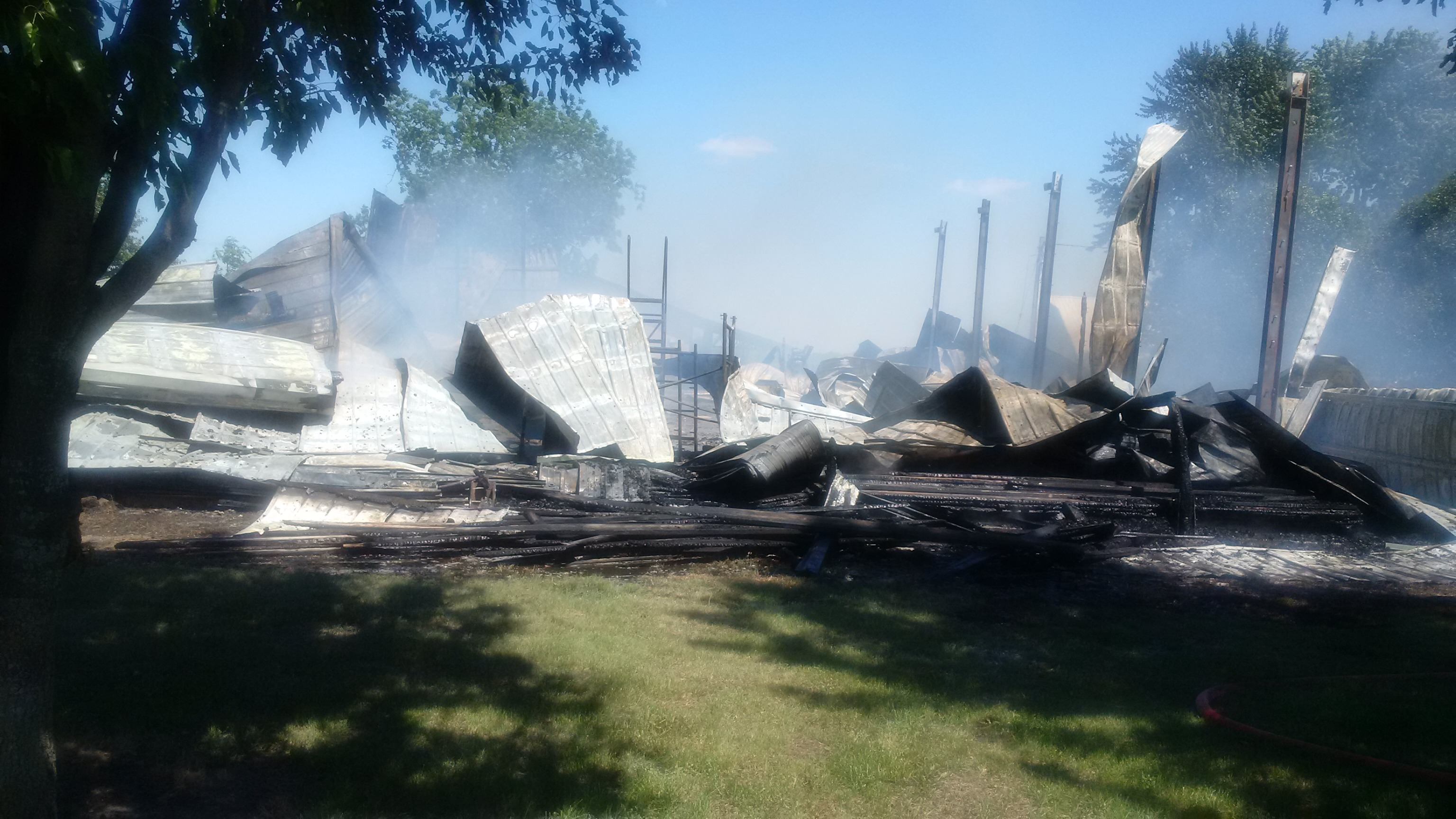 Fire in rural Carroll County destroys large out-building, injures one