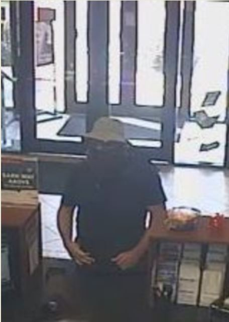Bank robbery  suspect sought in K.C. northland