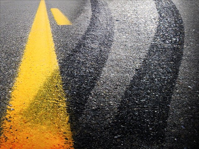 Wet roadway causes collision in Lafayette County