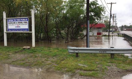 Wakenda Creek reaches flood banks in Carrollton
