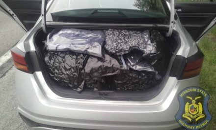Fictitious 911 report from motorist while stopped results in 130 lbs of marijuana seized