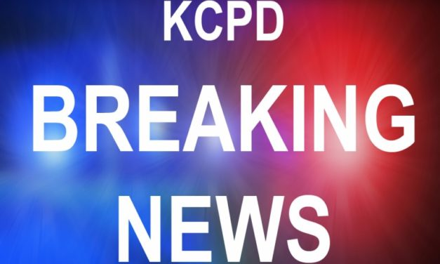KC Central Patrol Officers drug by vehicle while suspect tries to flee scene of crime