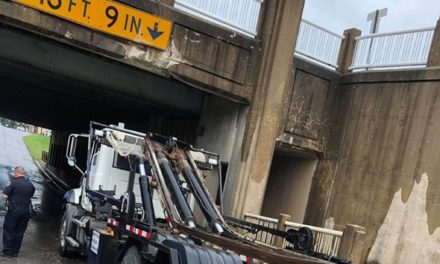 Truck with raised bed strikes Brookfield rail underpass