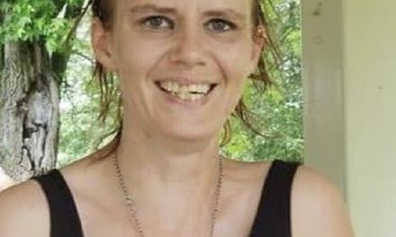 Body of missing woman found, charges filed.