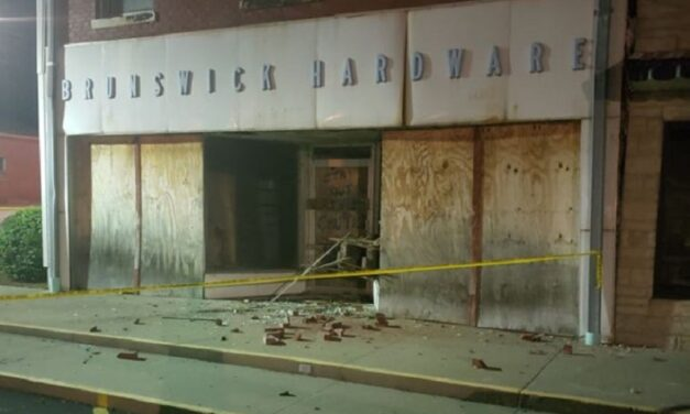 Pieces fall off Brunswick building Tuesday night, traffic being flagged through town