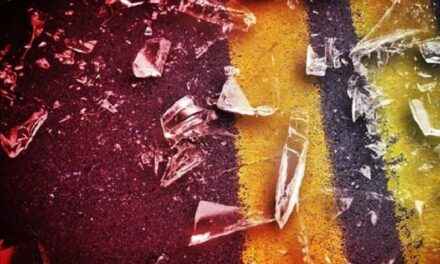 Two injured after car hits rock bluff